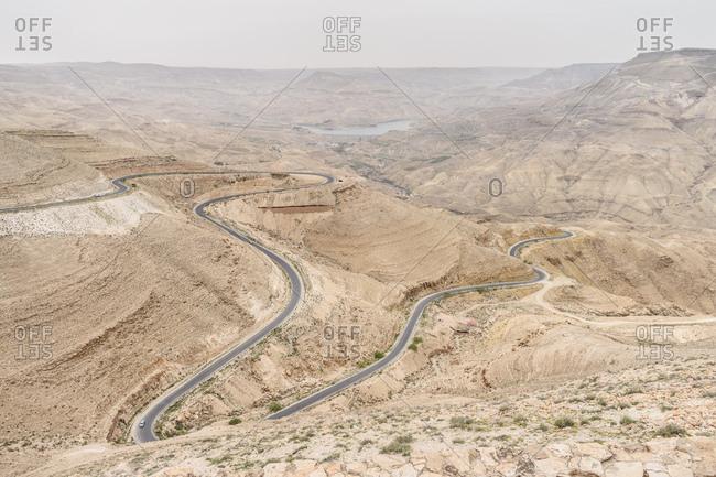 Winding road through arid landscape in Jordan