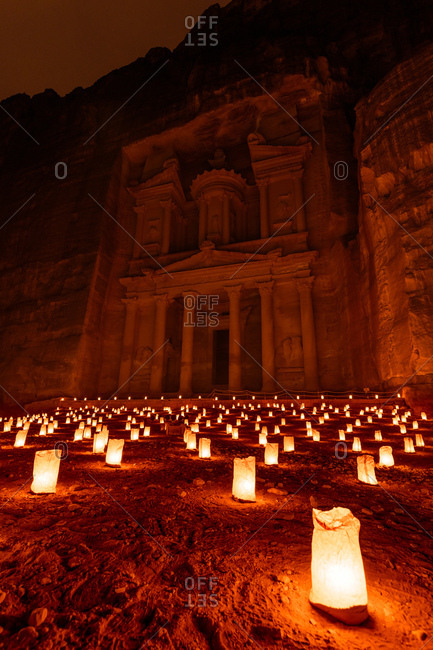 Candles glowing in front of the Al Khazneh temple in the ancient city of Petra in Jordan