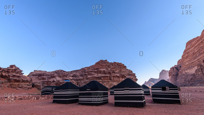 Tents set up at the base of rock formations in Wadi Rum in Jordan
