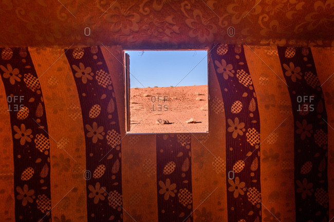 View of desert landscape of Wadi Rum in Jordan through window opening in tent