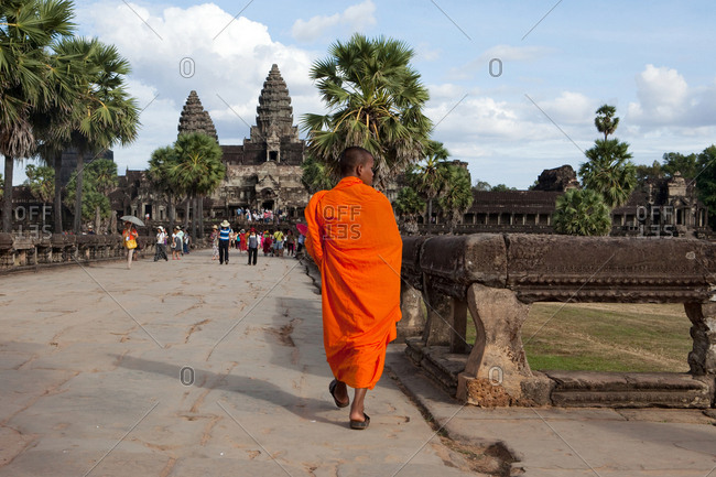 Angkor Wat, Sieam Reap, Cambodia - January 5, 2017: Buddhist monk walking through Angkor Wat