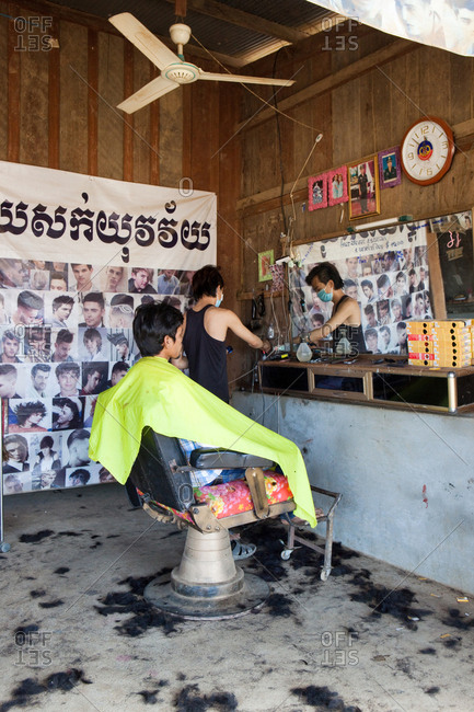 Cardamom Mountains, Koh Kong, Cambodia - January 9, 2017: Very simple barber shop with customer