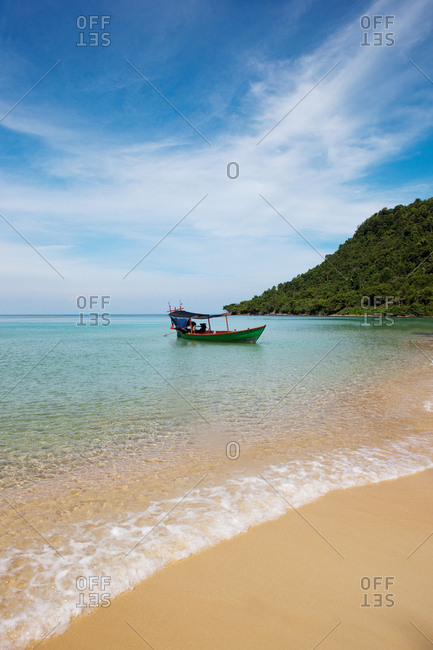 Longtail boat at a pristine beach