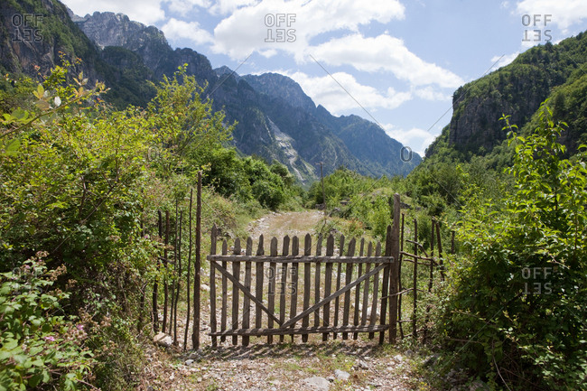 Wooden gate of a field in the mountains