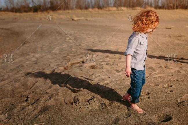 Child walking along beach