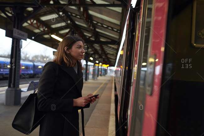 Businesswoman With Ticket Boarding Train Home