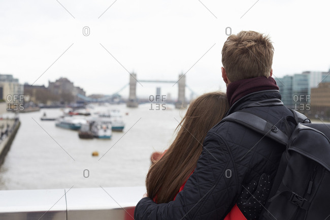 Couple Sightseeing In London Looking At Tower Bridge