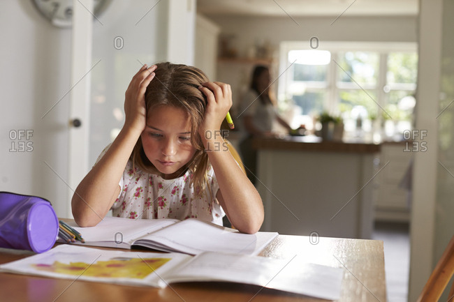 Girl frustrated by difficult homework