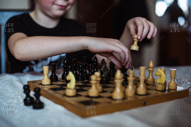 Close up of boy's hands playing chess