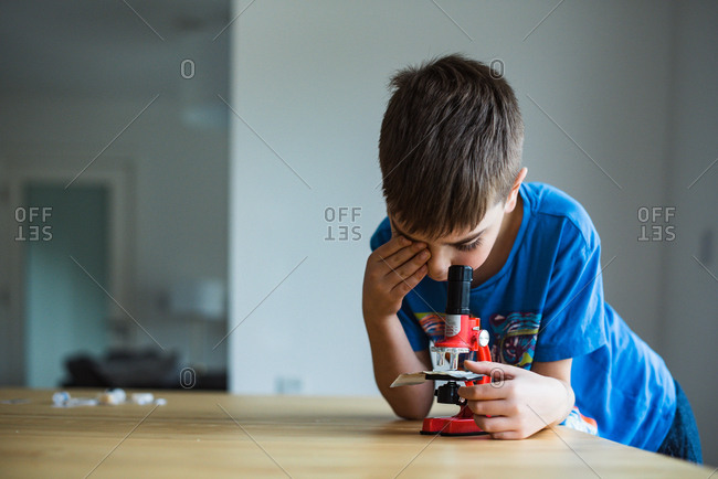 Boy looking through a microscope