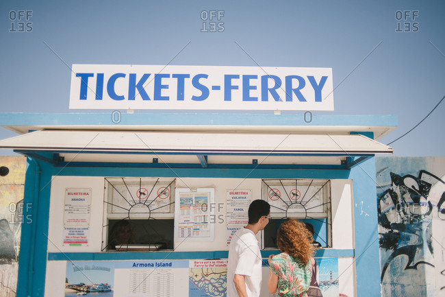Algavre, Portugal - February 4, 2017: Couple at ferry ticket booth