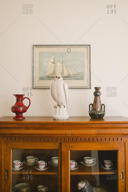 Snaefellsnes, Iceland - February 4, 2017: Ceramic falcon on sideboard with pottery