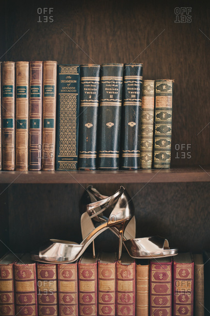 Snaefellsnes, Iceland - February 4, 2017: Women's silver high heeled shoes on antique books