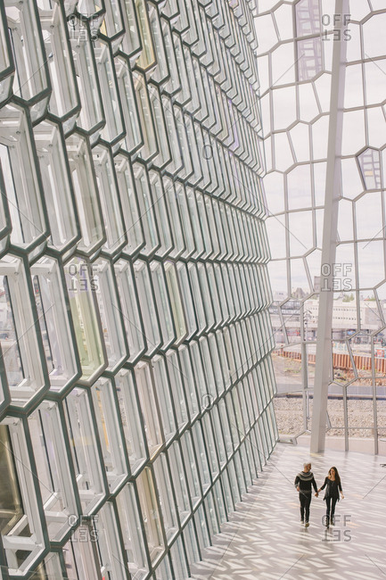 Reykjavik, Iceland - February 4, 2017: Couple walking in the Harpa concert hall