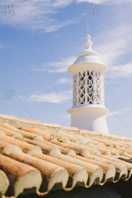Terra cotta roof tiles with bell tower