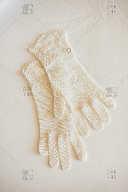 Pair of white crochet gloves