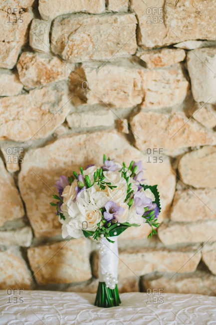 Bouquet of flowers against stone wall