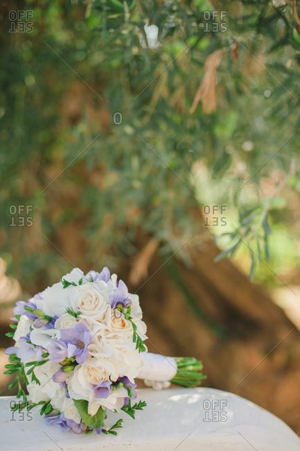 Wedding bouquet under tree in garden