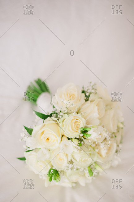 Overhead view of wedding bouquet of white roses