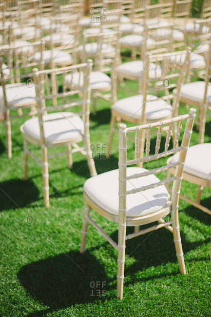Rows of chairs arranged on lawn