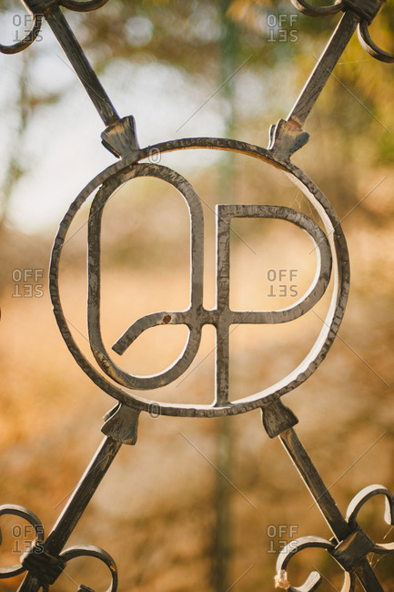 Metalwork monogram on gate