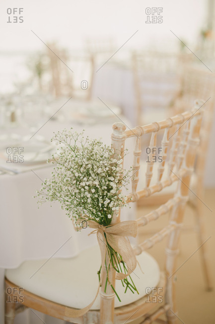 Chair decorated with baby's breath for wedding reception