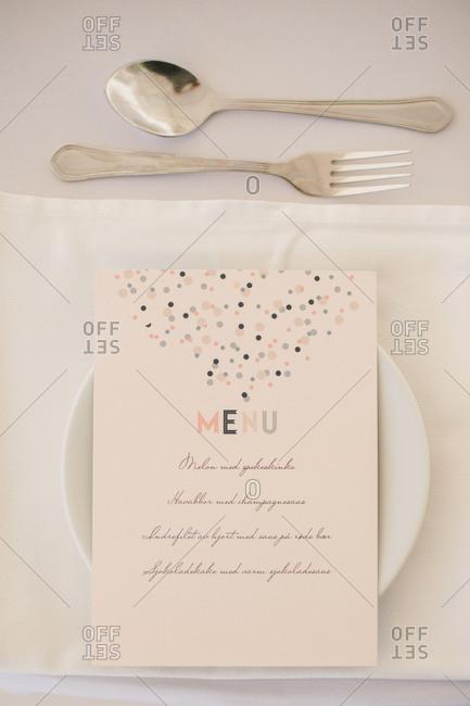 Printed dinner menu at place setting