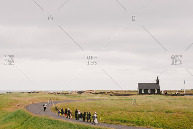 Bride's family accompanies her on walk to church in Iceland