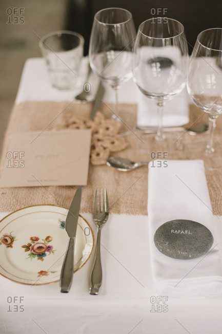 Wedding banquet table with stone place markers