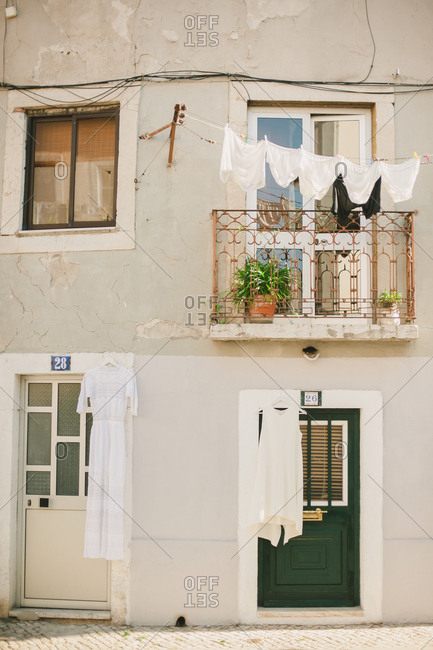Laundry hanging over a balcony on at a quaint street side apartment