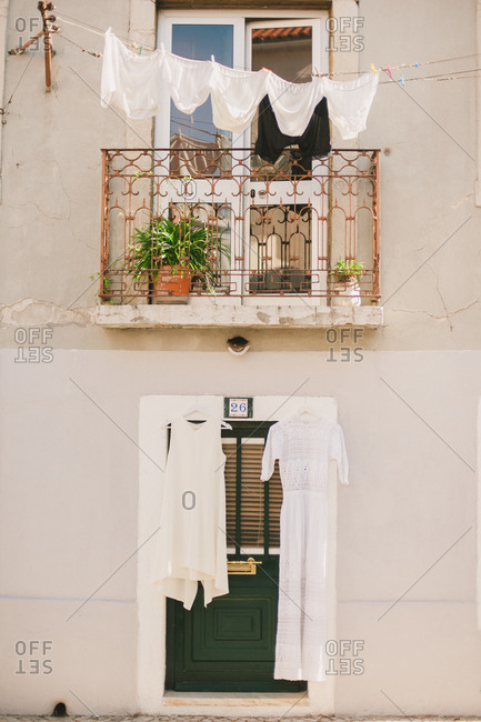 Clothes drying on the balcony of a quaint street side apartment