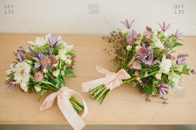 Bouquets of fresh flowers wrapped in pink ribbon