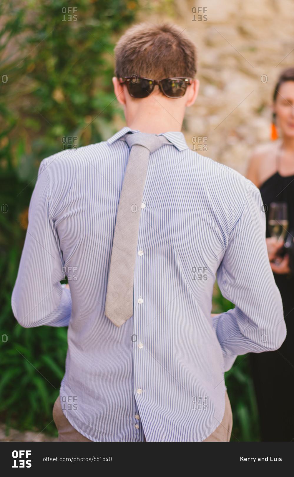Backwards stock photos offset man wearing a shirt tie and sunglasses backwards ccuart Choice Image
