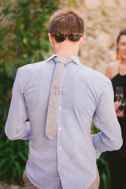Man wearing a shirt tie and sunglasses backwards stock photo offset ccuart Image collections