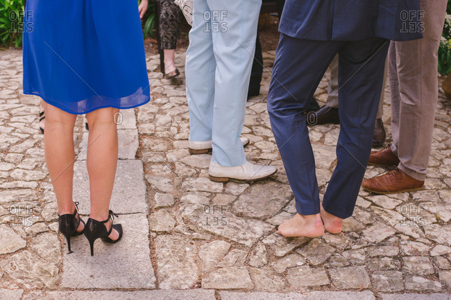 People standing around a stone patio in formalwear