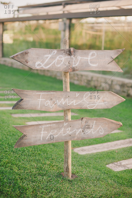 Wooden directional signs for love, family and friends