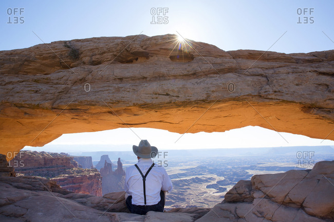 Man at Mesa Arch in Moab, Utah, United States