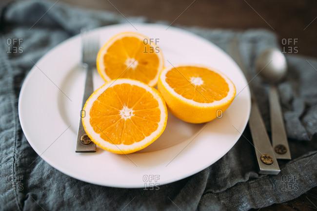 Oranges sliced on a plate