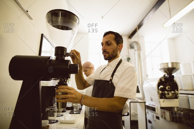 Barista preparing coffee in the coffee shop