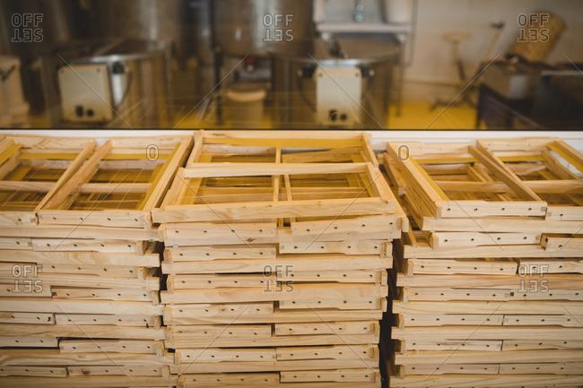 Stacks of honey wooden frames in factory