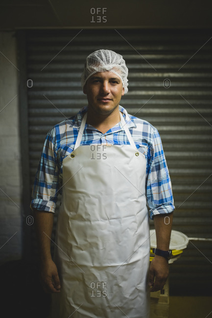 Portrait of male beekeeper wearing protective headdress at beekeeping factory