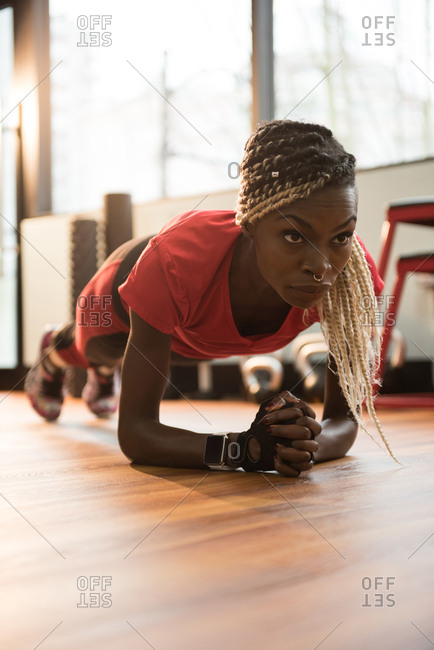 Fit woman performing fitness exercise in the gym
