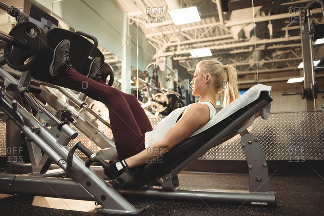 Fit woman exercising on a machine in the gym