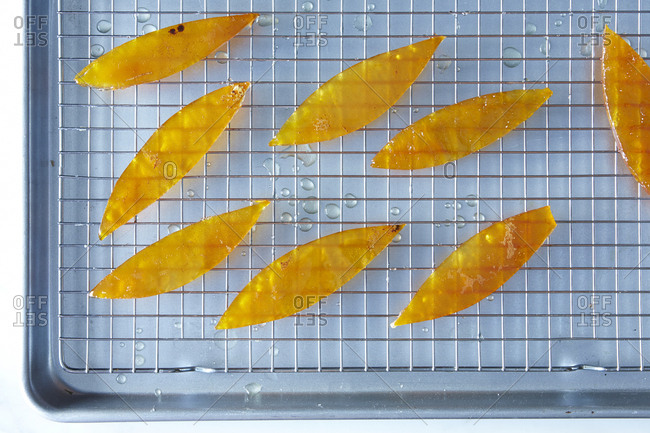 Candied citrus peels on cooling rack