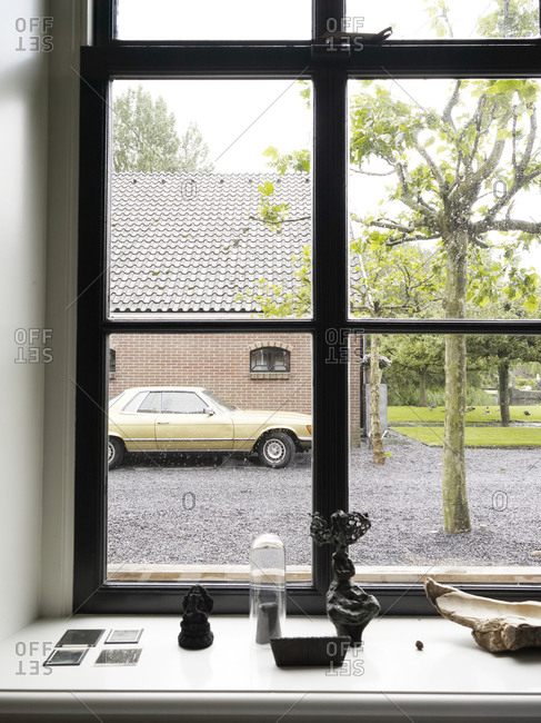 Amsterdam, Netherlands - June 15, 2012: Old car seen from inside house