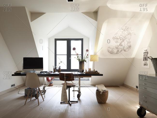 Amsterdam, Netherlands - June 15, 2012: Home office in top floor