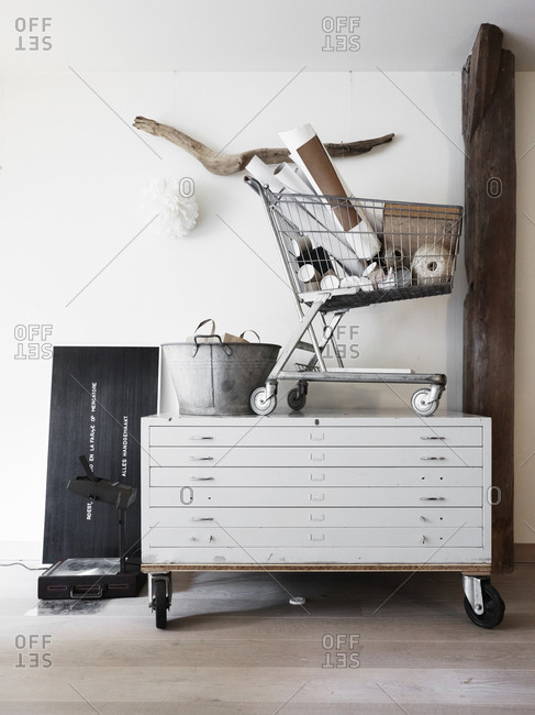 Amsterdam, Netherlands - June 15, 2012: Shopping cart on filing cabinet