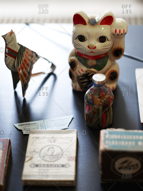 Amsterdam, Netherlands - June 15, 2012: Waving cat in sunlight on table