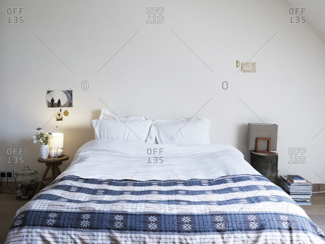 Amsterdam, Netherlands - June 15, 2012: Cozy bed in simple setting