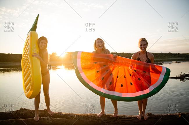 Three millennial women enjoying a summer day on the lake